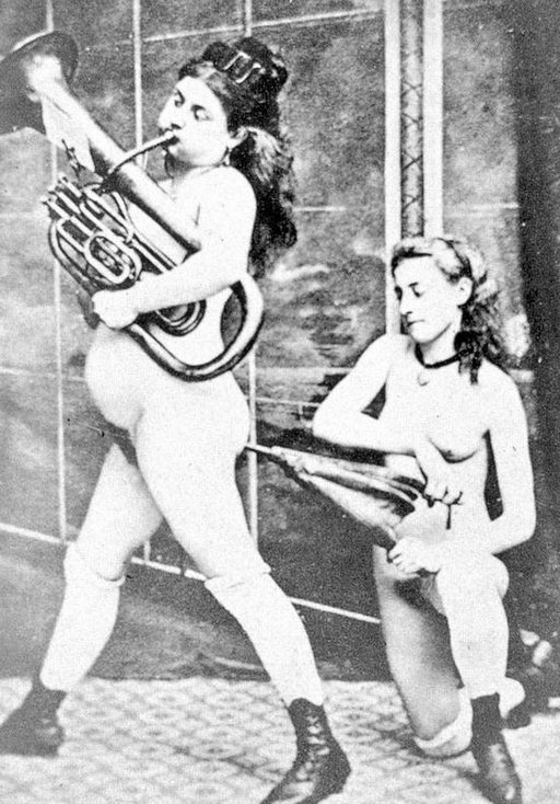 "woman playing a brass instrument being ""inflated\"" by an anal bellows"