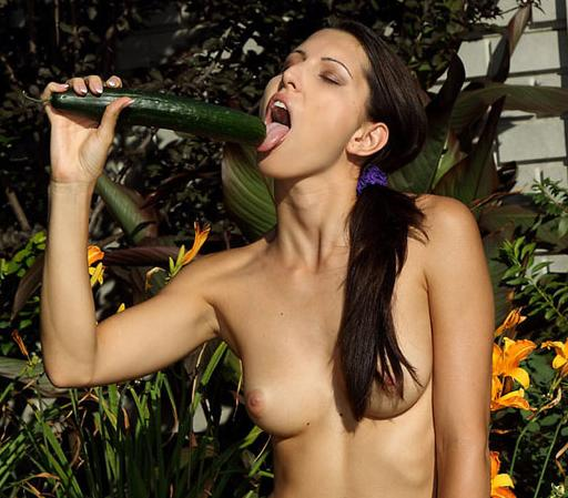 ALS model preparing to use a cucumber as a sex toy