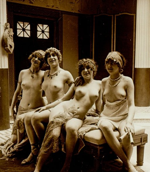 four naked worshippers of bacchus on a bench