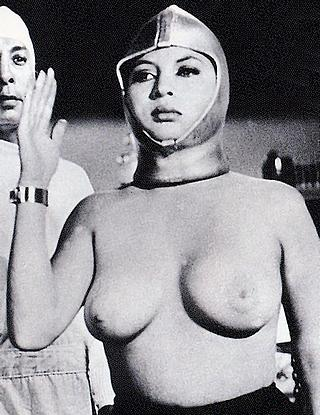 unhappy topless woman in monster movie