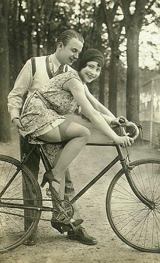 pretty girl getting fondled on a bicycle