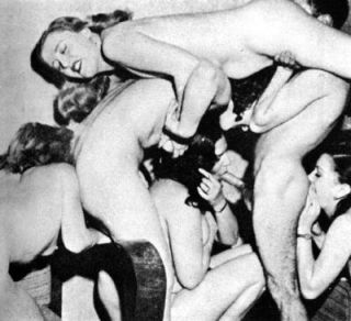four women and two men having an orgy