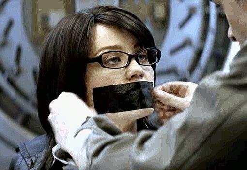 Erika Christensen gagged with black tape