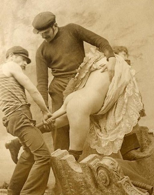 two ruffians inserting a long stick or tube in a woman's butt