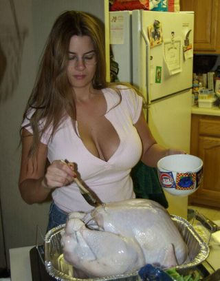 large-breasted beauty buttering a turkey
