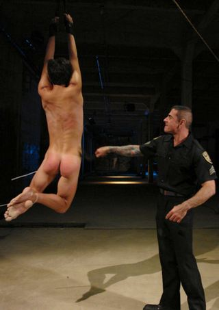 gay caning and suspension scene