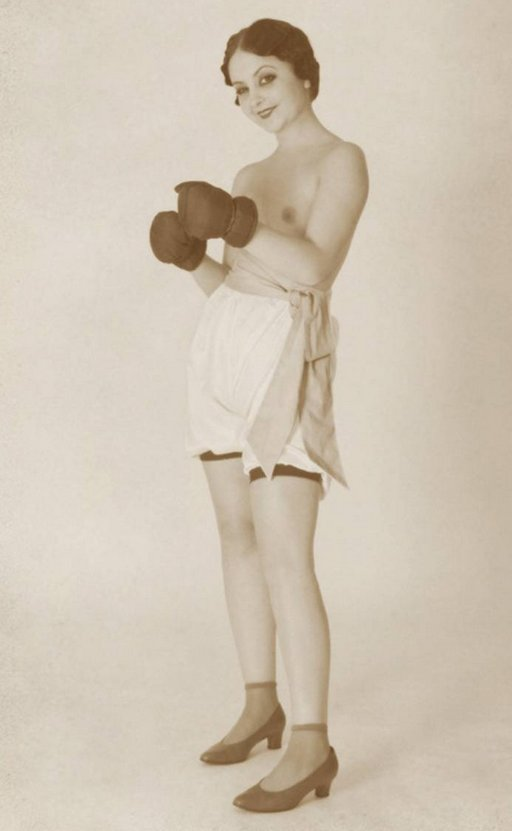 topless vintage woman wearing boxing gloves