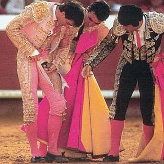 matador counting his balls after a close encounter with bull