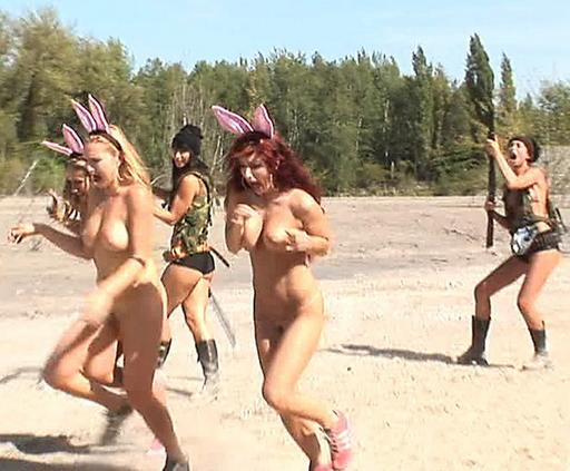sexy topless bunny girls scatter in badly-acted mock fear before the hunt begins