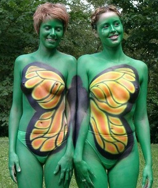 nude mother-daughter pair painted like a butterfly