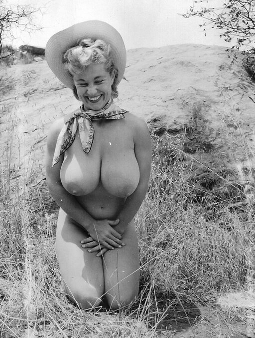 virginia bell kneeling and grinning