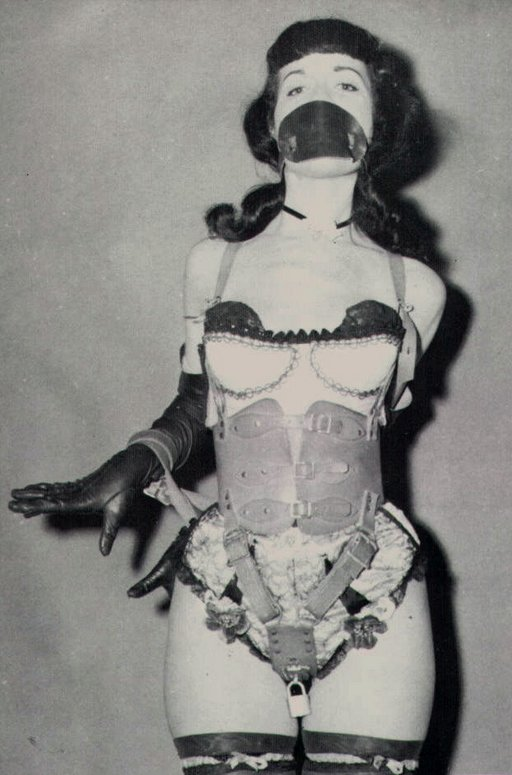 lace ruffled corset and leather chastity belt