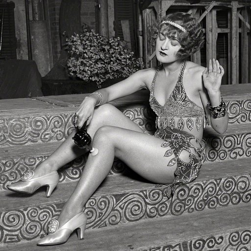 chorus girl using a vibrator ... on her sore leg muscles