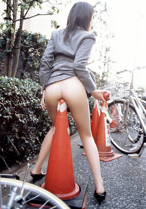 sitting on a traffic cone in pantyhose