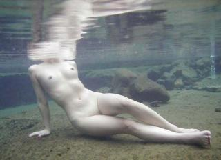 nude woman mostly underwater