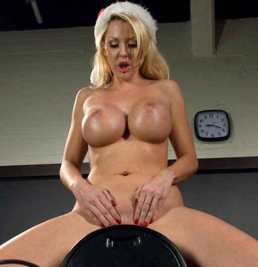 Penny look-alike wearing a Christmas had and riding a Sybian to orgasm