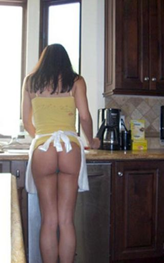 Adrianna Curry cooking with her bottom showing