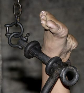 well turned ankle trapped in steel bondage