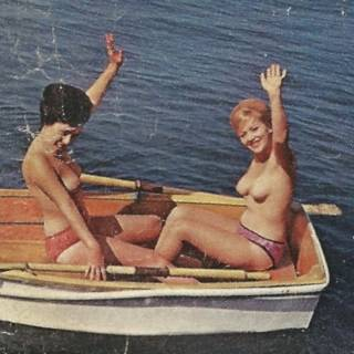 two nudes in a rowboat