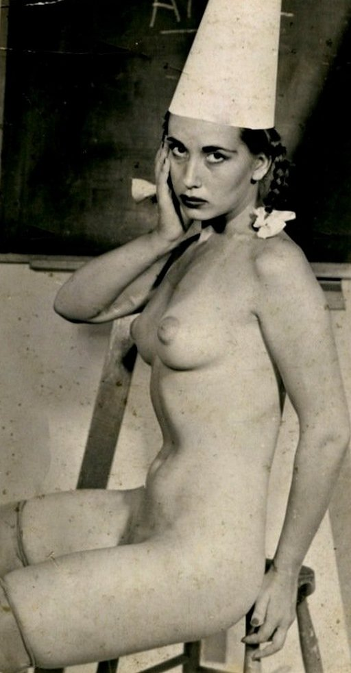 pretty vintage nude wearing a dunce cap