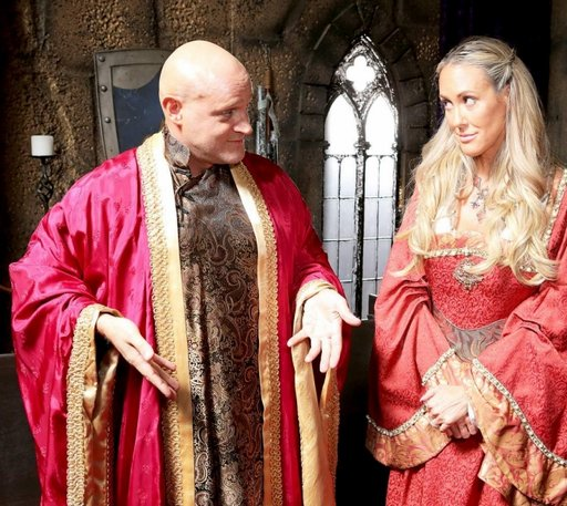 Alec Knight as Varys has a surprise under his robe for Brandi Love as Cersei