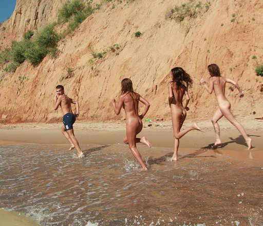 running slowly away from the nudist women