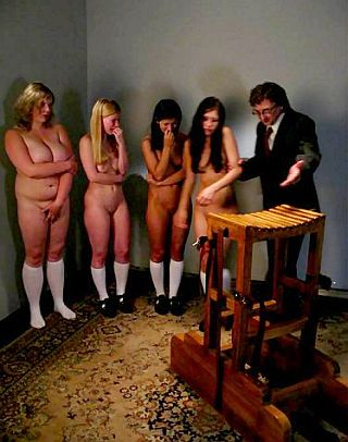 four young women about to be caned on their bottoms