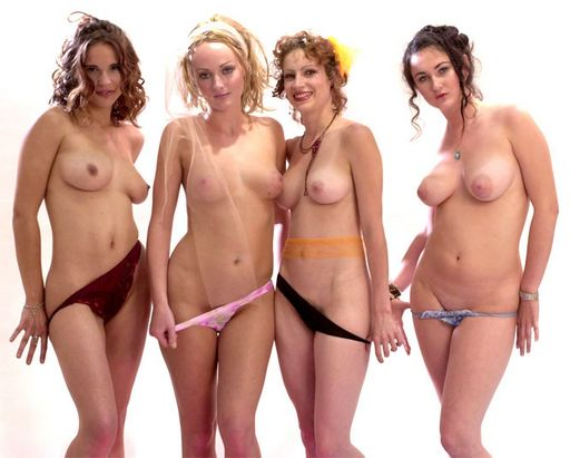 four topless lesbians teasing the camera before stripping off their panties