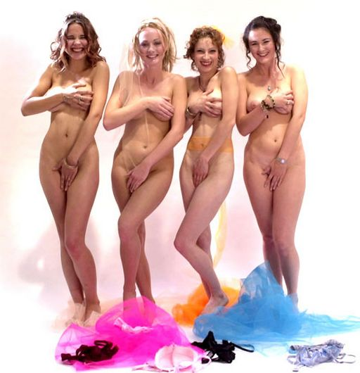 four nude women pretending to be shy and hide their pussies from the camera with their hands