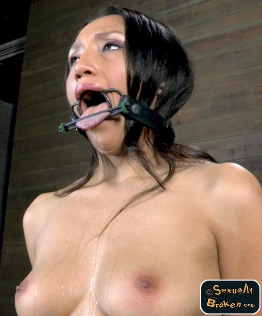 Vicki Chase wearing a ring gag and a tongue binder at Sexually Broken
