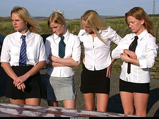 young ladies in schoolgirl outfits getting ready to show their bottoms