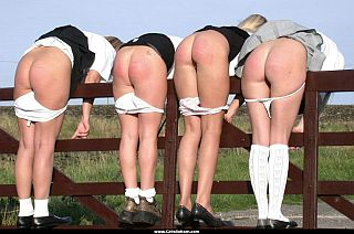spanked young ladies bent over a fence