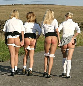 caned young ladies out for a country stroll