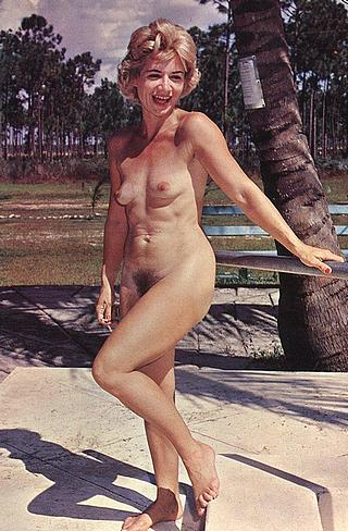 nudist woman smiling in the sunshine