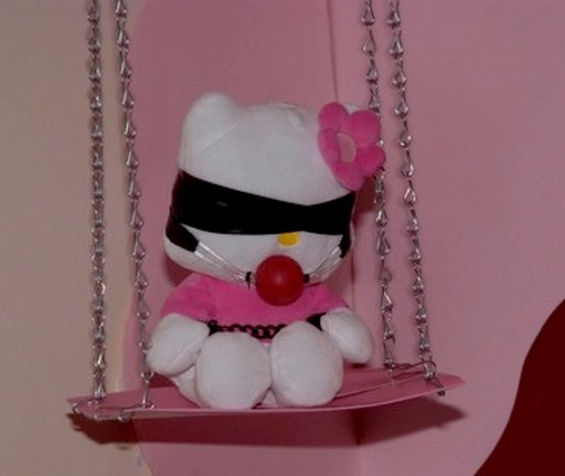 Hello Kitty doll wearing blindfold and gag