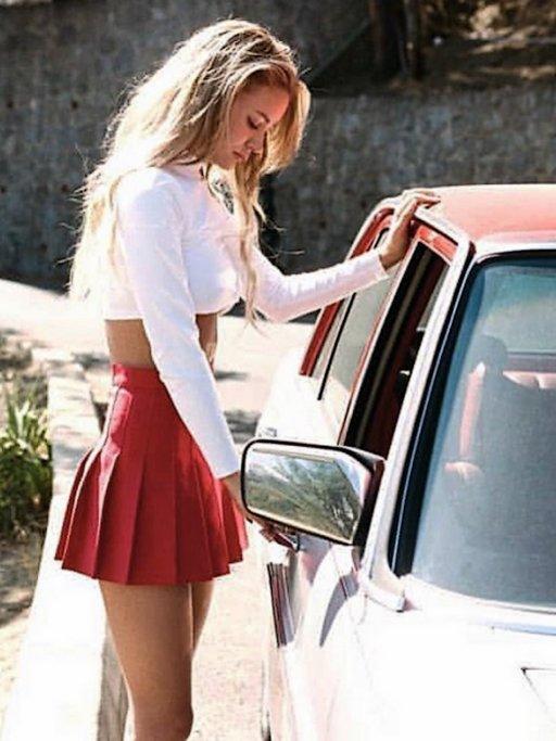 blonde cheerleader approaching dirty old man in vintage car