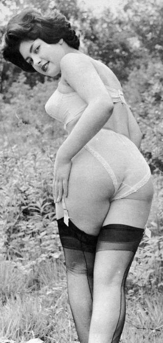 June Palmer looking expectantly over her shoulder as if waiting for a spanking
