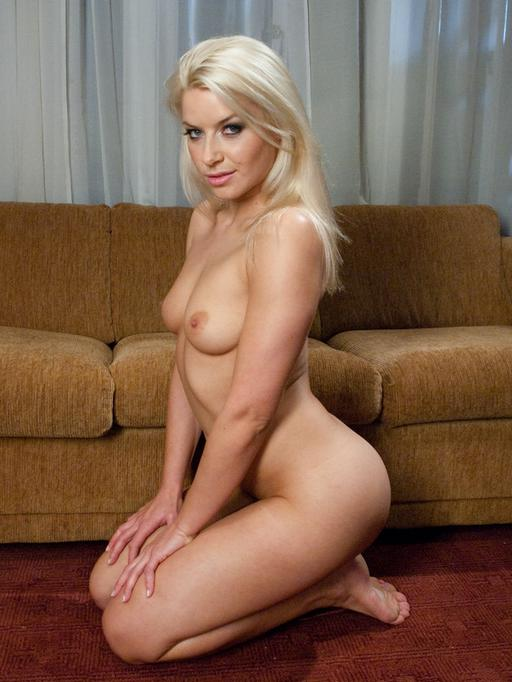 blonde Annika Albright kneeling and posing