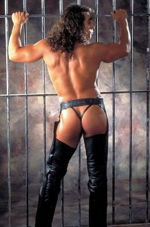 Leather Chaps and a Bare Ass Behind Bars = Sexy Man!