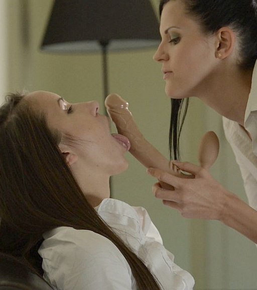 dominant lesbian makes her sub lick the double-ended feeldoe dildo that they are about to have sex with