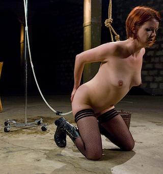 lilla-katt-kneeling-and-receiving-an-enema.jpg