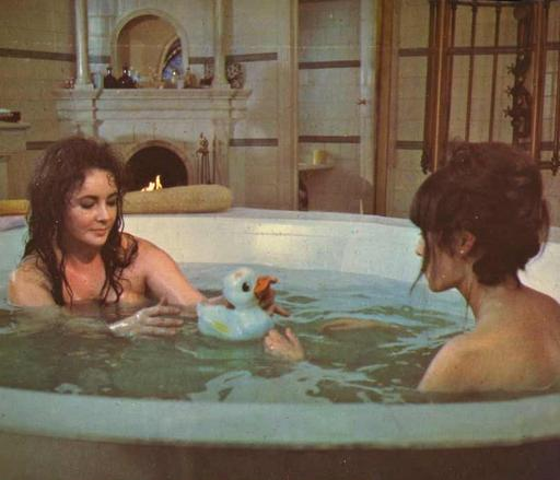 Elizabeth Taylor and Mia Farrow in a jacuzzi