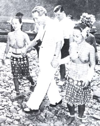 Malcom MacDonald among the Dayak women