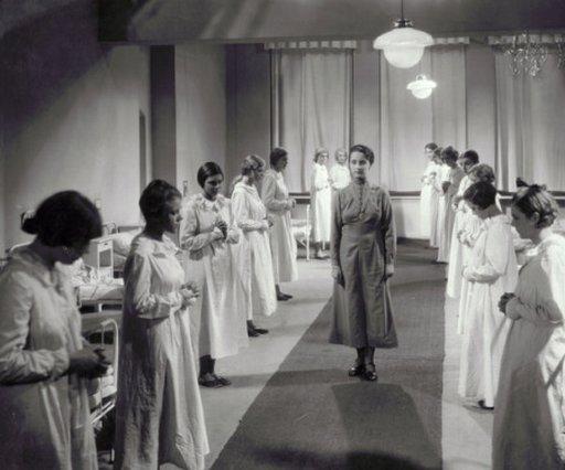 girls boarding school dormitory scene preparing for bedtime kisses