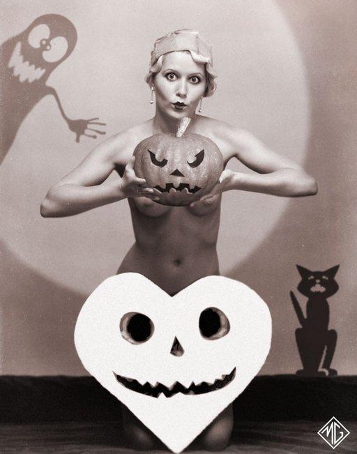 kneeling burlesque cutie hides her tits behind a jackolantern pumpkin