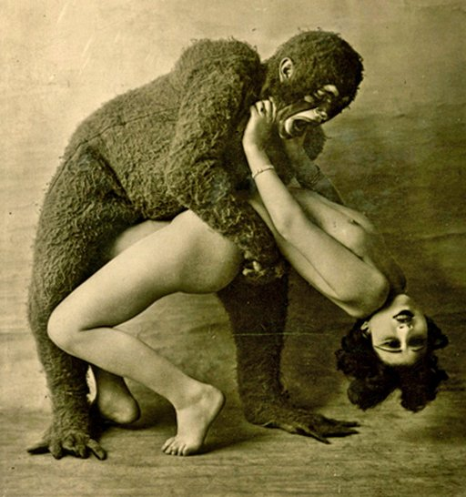 person in a scary plush animal suit attacking a woman
