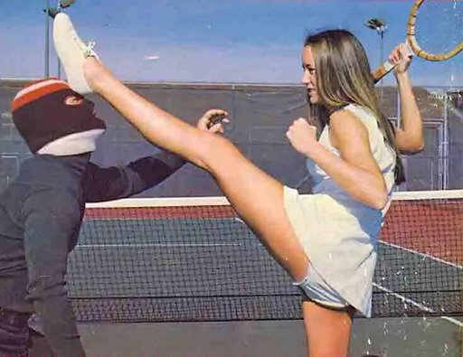 tennis chick beating up a masked mugger in broad daylight on the tennis court