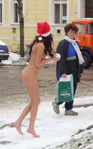 nude woman prepares to throw a holiday snowball