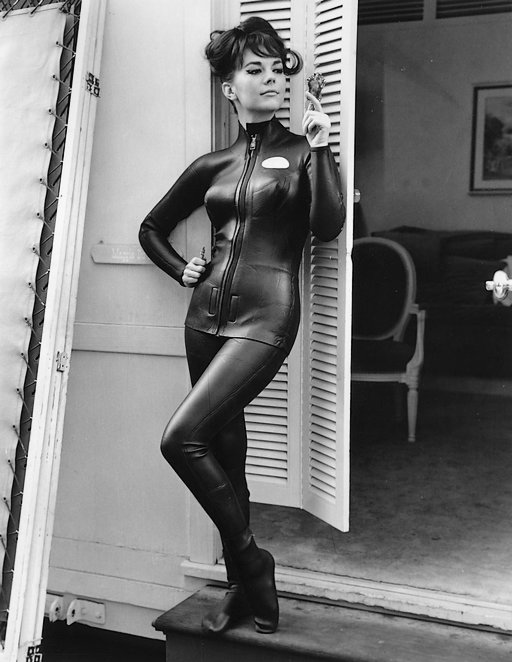 natalie wood wearing a form-fitting rubber wet suit with zippers