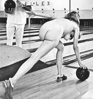 nude girl throwing a bowling ball